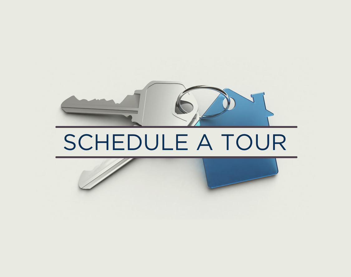 An image of keys with text that states schedule a tour.