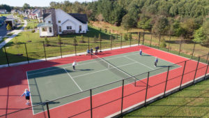 playing tennis at millers grant retirement community ellicott city md