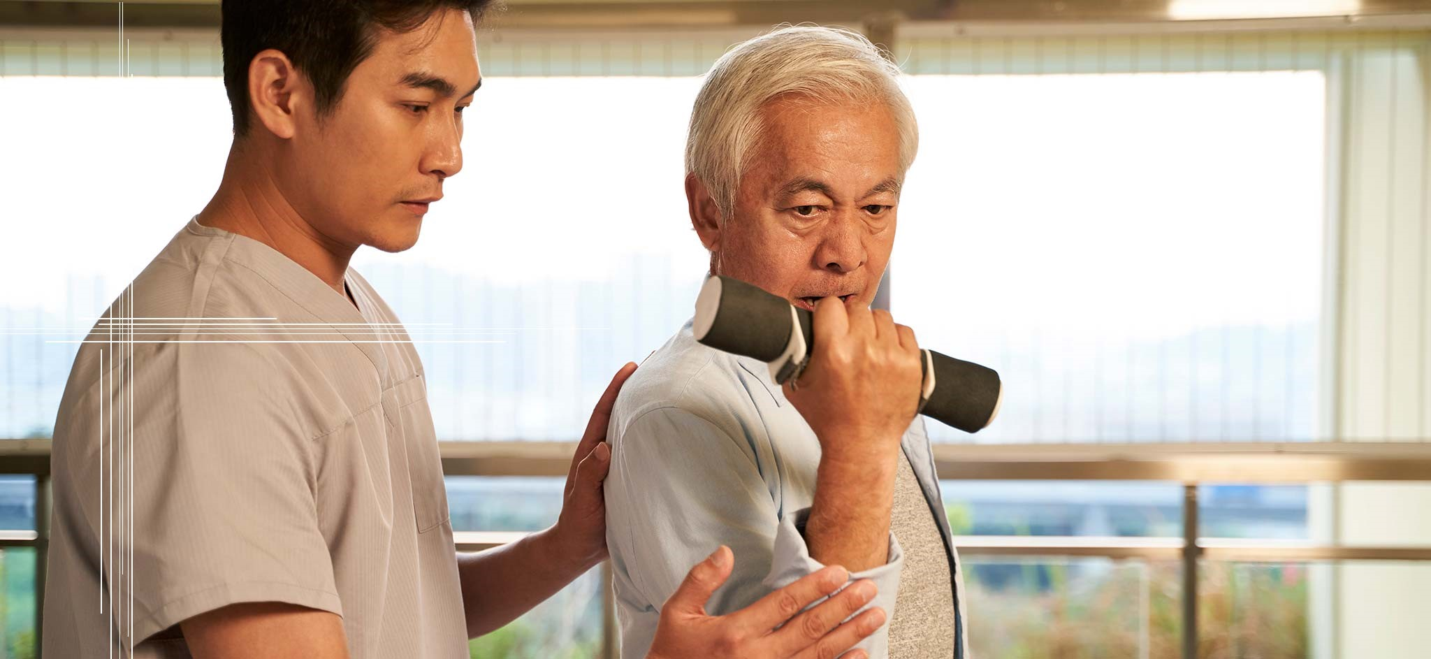 A physical therapist assisting an older man with his exercises